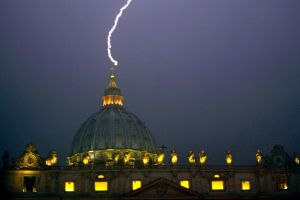 A%20lightning%20strikes%20St%20Peter's%20dome%20at%20the%20Vatican%20on%20February%2011-1704567